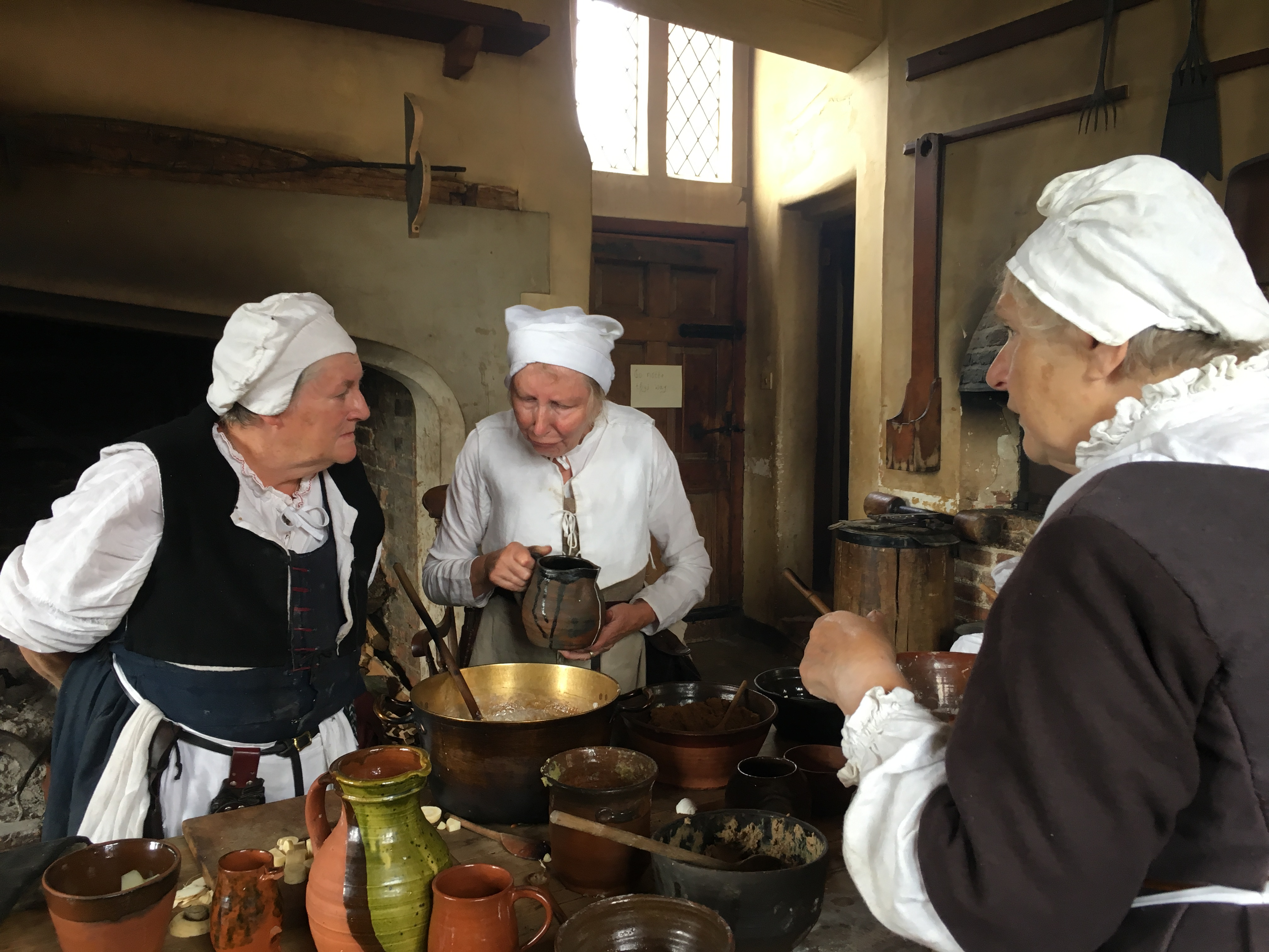 Cooks talking over the cooking at Tudor Kentwell