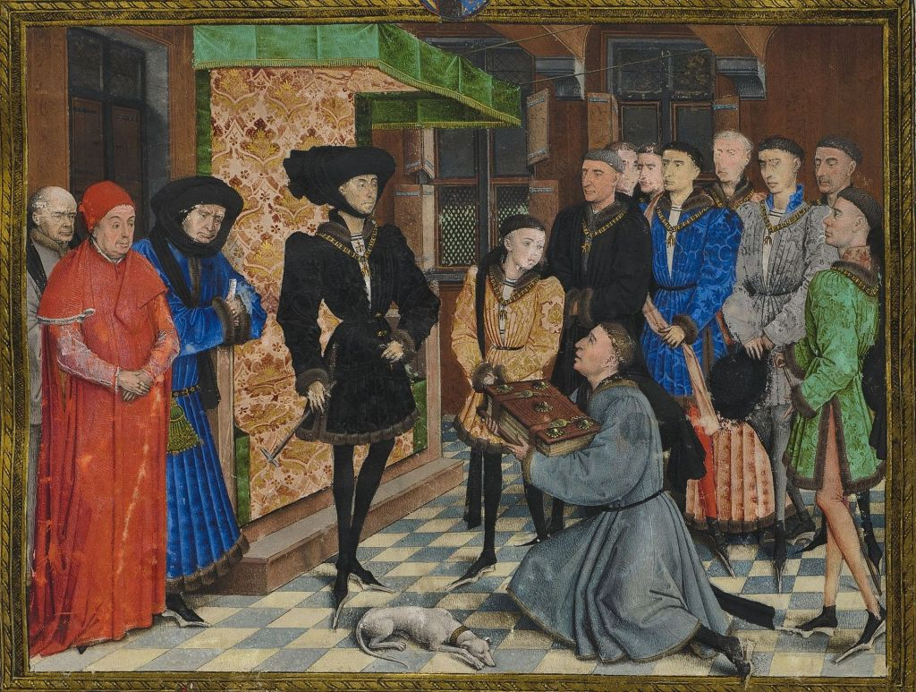 A picture of a medieval scenes of a kneeling man presenting a book to Philip the Good.