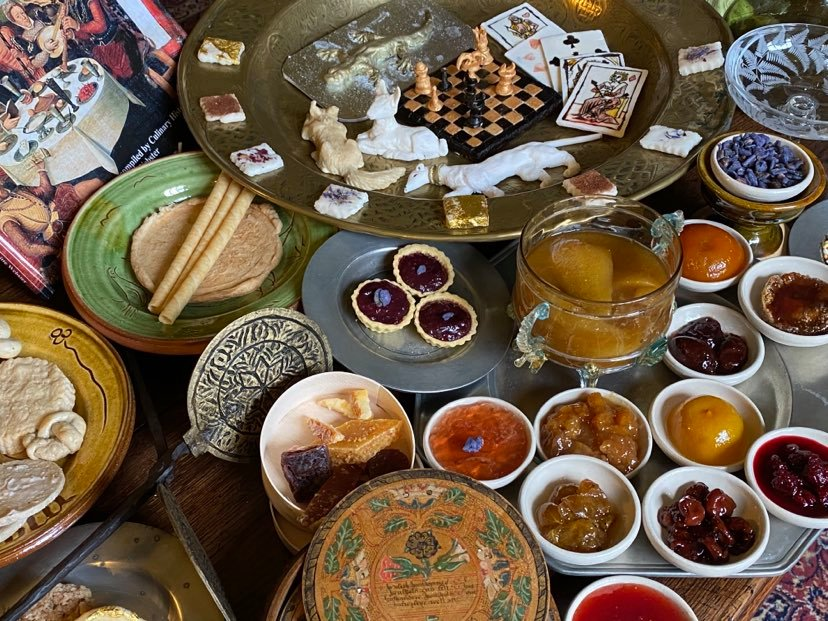 An array of different, colourful Tudor dishes in decorative bowls and platters.